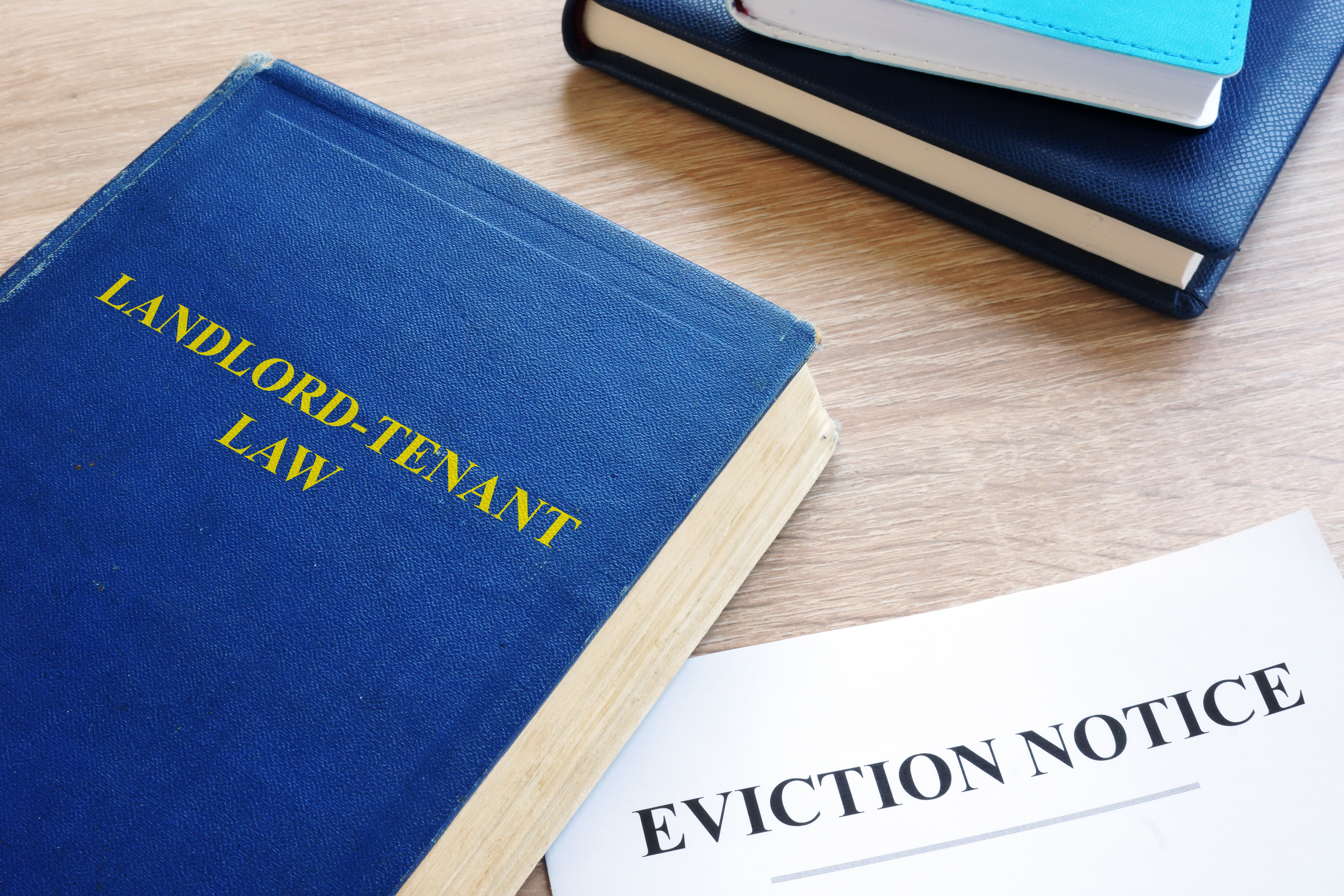 Landlord-Tenant Law and eviction notice on a desk.
