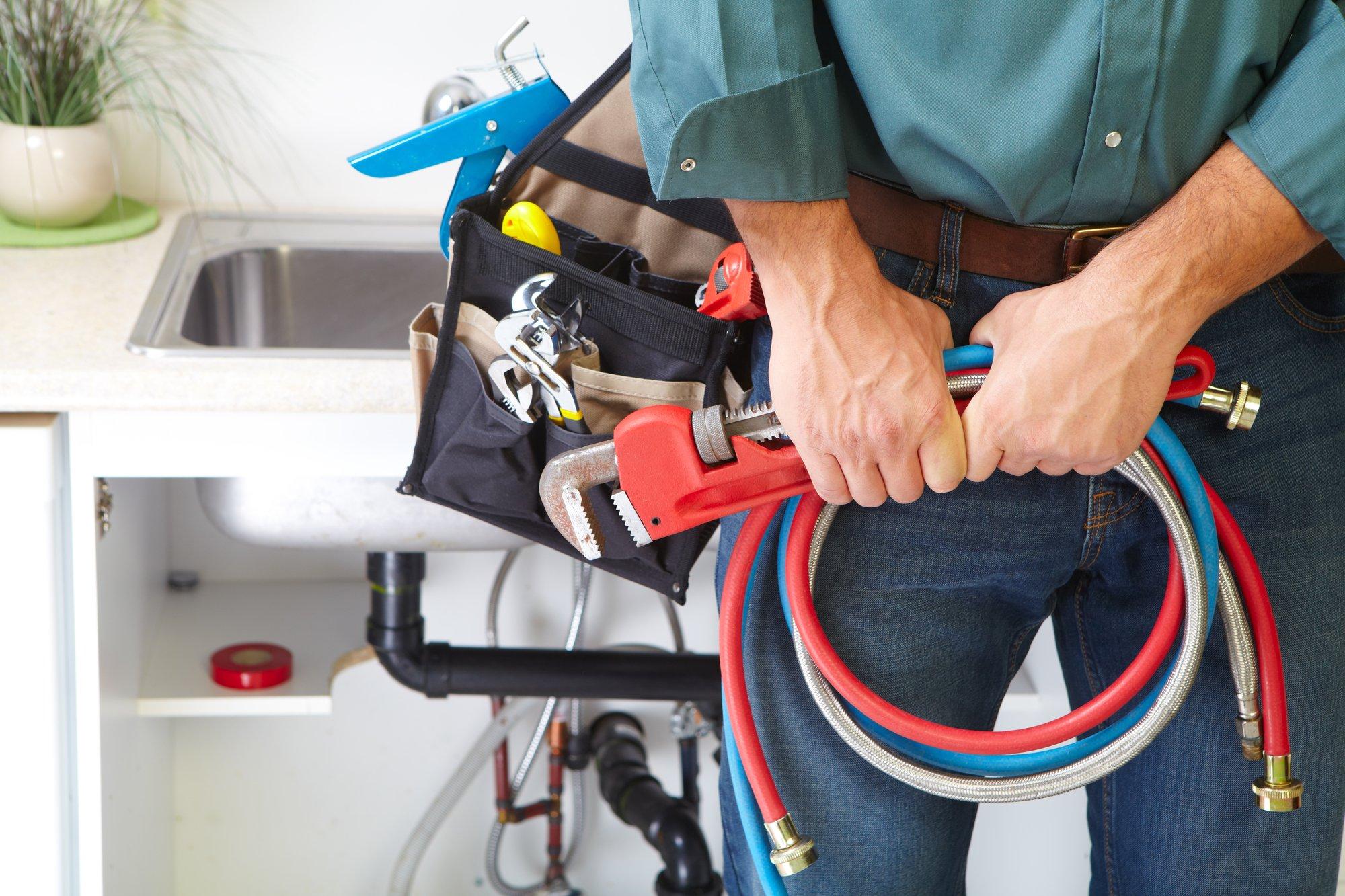 man wearing toolbelt for maintenance